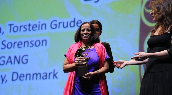 GULABI GANG director Nishtha Jain receives the award for Best Film in the Muhr AsiaAfrica Documentary section of the 9th Dubai International Film Festival